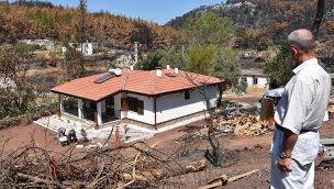 Orman yangınında evleri yanan Şahin çifti yeni evlerine kavuştu